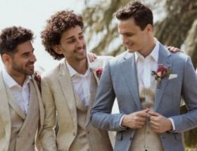 Hombres con trajes para boda en primavera.